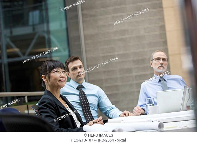 Business people listening attentively in conference room meeting