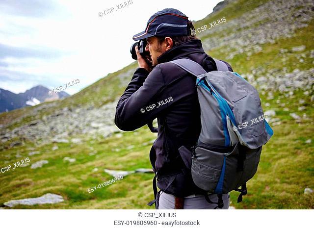 Hiker taking photos of landscape