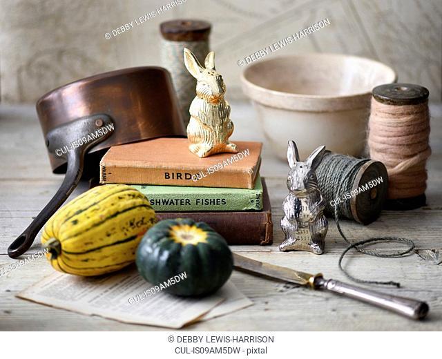 Vegetables, books, rabbit figurines, string, pot