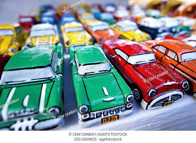 Painted papier mache model cars on the open air market, Trinidad, Sancti Spíritus Province, Cuba, Central America