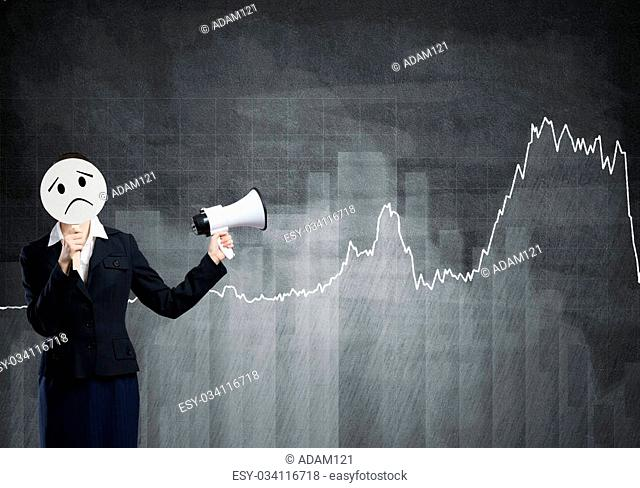 Unrecognizable businesswoman with megaphone and diagrams at background