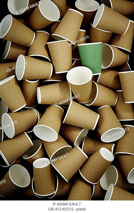 Full frame green recyclable coffee cup among disposable cups