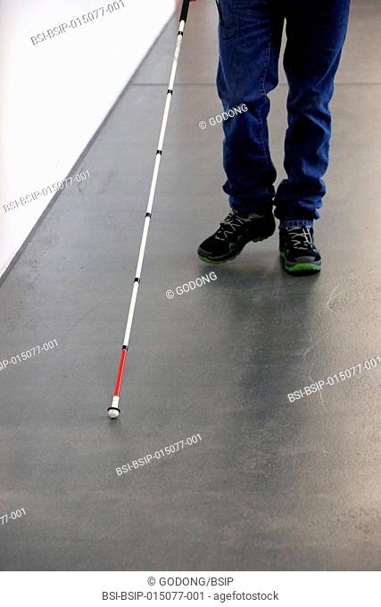 Blind man using a cane