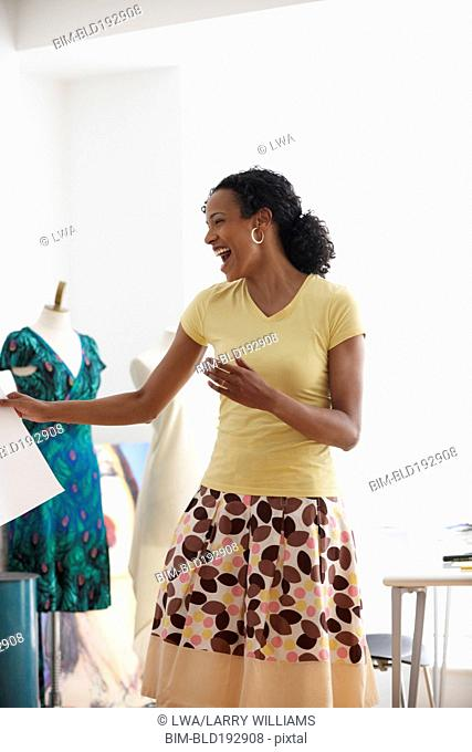 African woman laughing in design studio