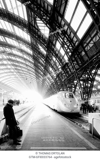 Atmospheric shot of train in station with arched ceiling