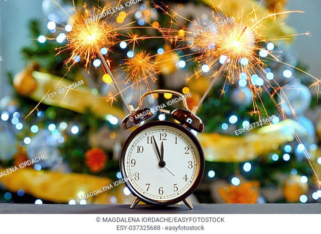 Happy New Year concept with Sparkler Fireworks and clock