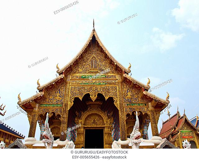 A golden buddhist monastery in Wat Baan Den in Chiang Mai, Thailand built by Northern Thai architectural style