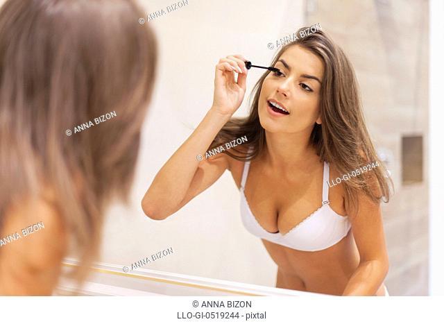 Brunette woman preparing makeup in bathroom. Debica, Poland