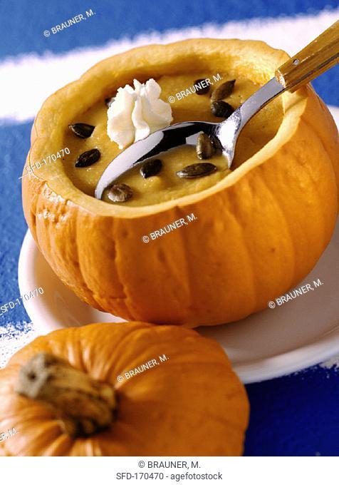 Honeyed pumpkin soup in hollowed-out pumpkin
