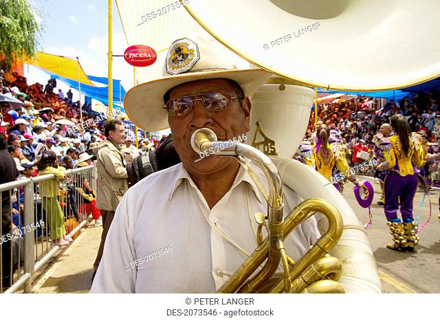 Tuba Player In A Marching Band In The Procession Of The Carnaval De Oruro, Oruro, Bolivia