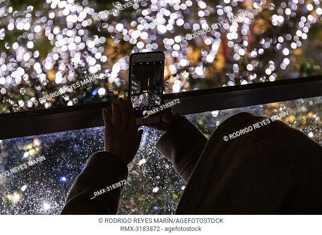 November 19, 2018, Tokyo, Japan - A visitor takes pictures of the winter decorations at Roppongi Hills in Tokyo. Approximately 700