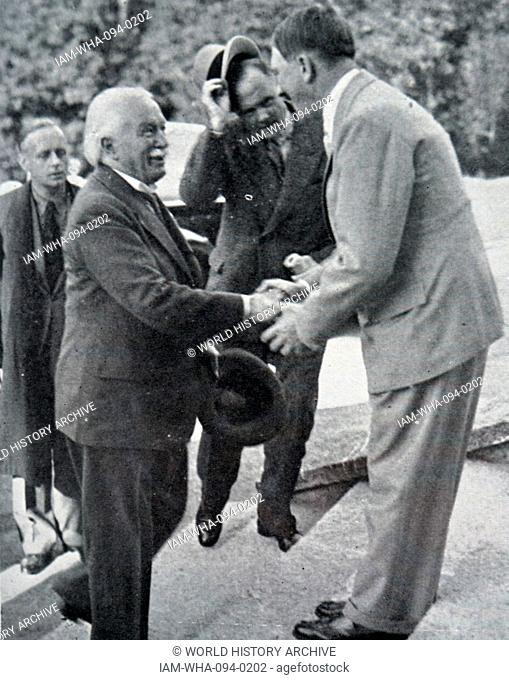 Photograph of David Lloyd George (1863-1945) former Chancellor of the Exchequer, meeting with Adolf Hitler (1889 – 1945); Austrian-born German politician who...