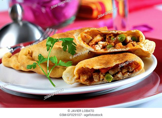Empanadas pastries with fish filling opened