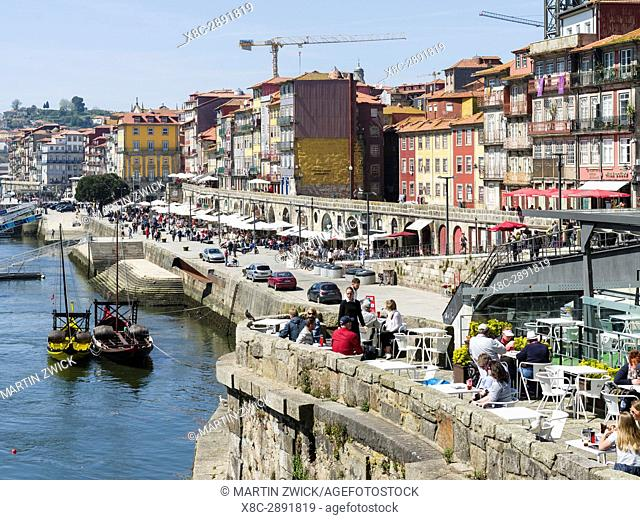 The quarter Ribeira at the old harbour in the old town with the iconic row of houses. City Porto (Oporto) at Rio Douro in the north of Portugal