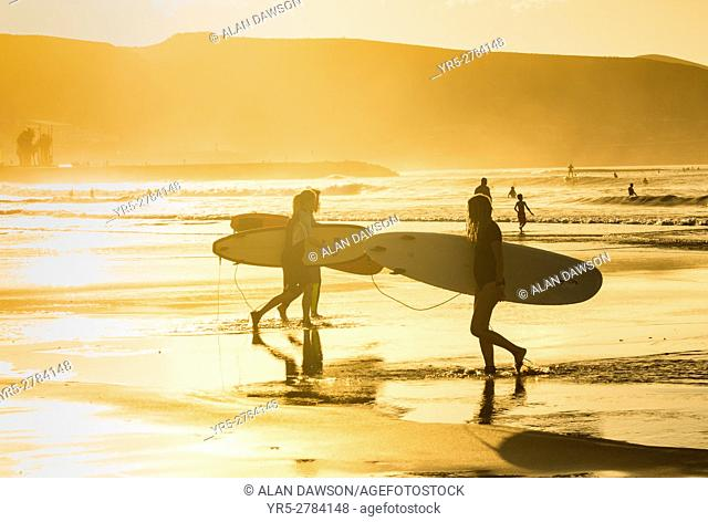 Surfers at sunset at La Cicer on Las Canteras beach, Las Palmas, Gran Canaria, Canary Islands, Spain