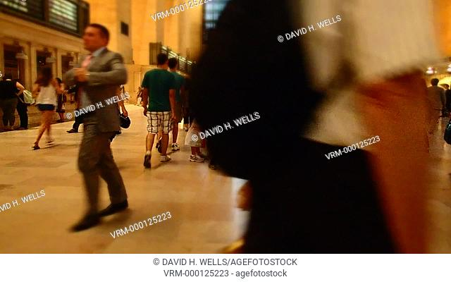 Pedestrians walking in Grand Central Station in New York, New York, distorted with an art filter and time-lapse imaging