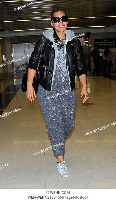Pregnant Alicia Keys arrives at LAX airport, wearing a long grey sparkly dress, sunglasses and trainers. Featuring: Alicia Keys Where: Los Angeles, California