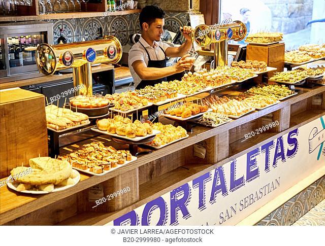 Waiter serving beer, Ham, Pintxos, Bar Restaurante Portaletas, Parte Vieja, Old Town, Donostia, San Sebastian, Gipuzkoa, Basque Country, Spain