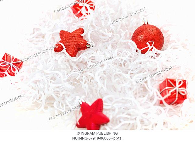 Red christmas decoration on a white tinsel