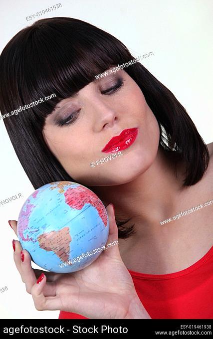 Woman holding a mini-globe