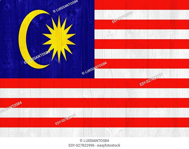 gorgeous Malaysia flag painted on a wood plank texture
