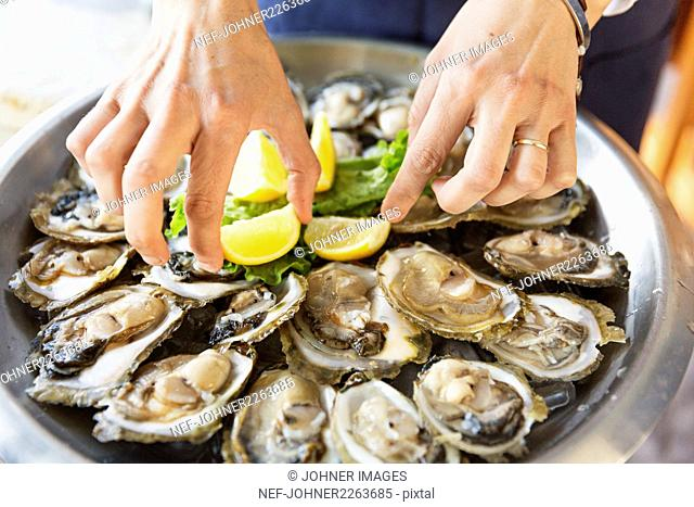 Eating oysters, close-up