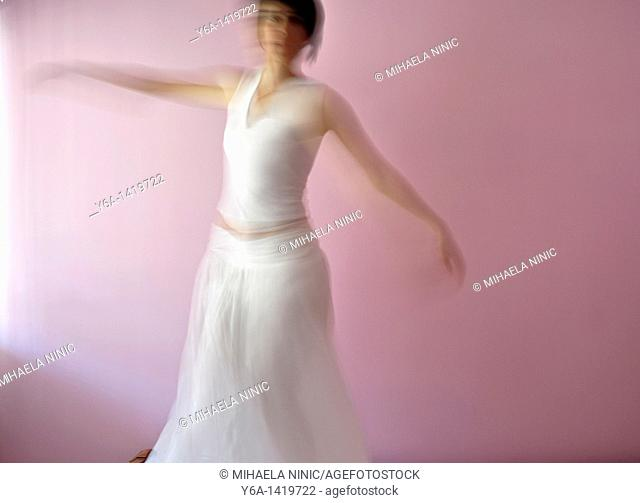 Blurred image of a woman dancing