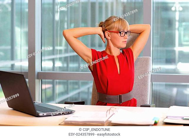woman in eyeglasses relaxing neck