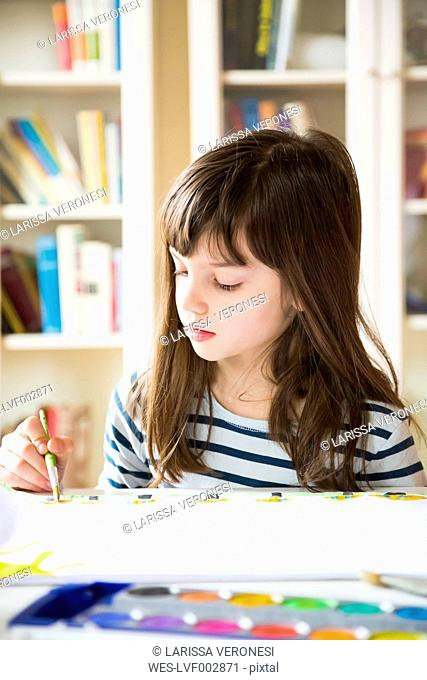 Girl painting with watercolours