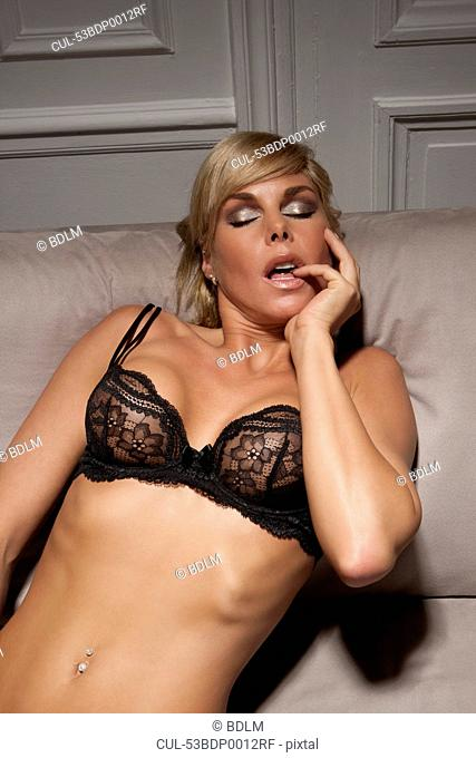 Woman in lingerie laying on sofa