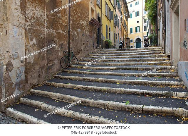 Steps with a parked bicycle centro storico district old town Rome Italy Europe