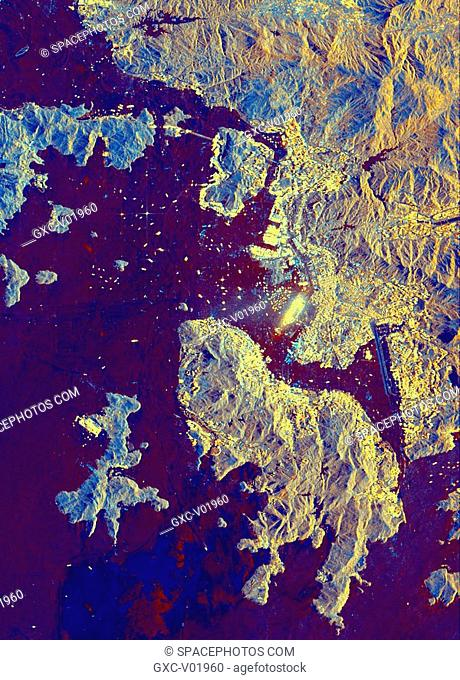 This spaceborne radar image shows part of the British territory of Hong Kong, adjacent to mainland China. The South China Sea is shown in dark blue and red on...