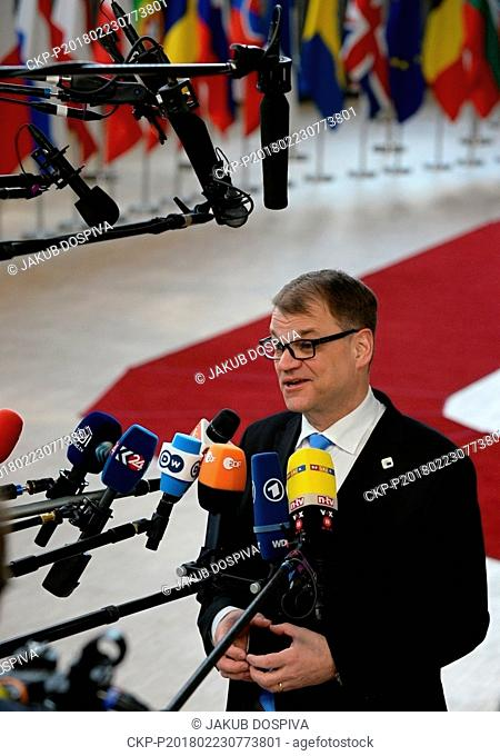 The Prime Minister of Finland JUHA SIPILA speaks with journalist prior to an EU summit at the Europa building in Brussels on Friday, Feb. 23, 2018