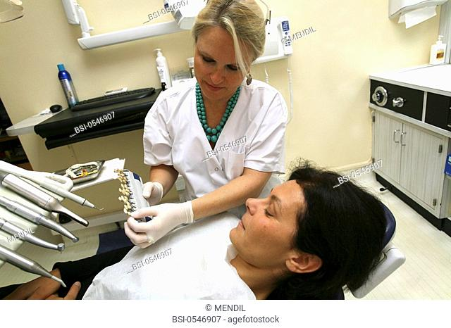WOMAN RECEIVING DENTAL CARE Photo essay from dental office