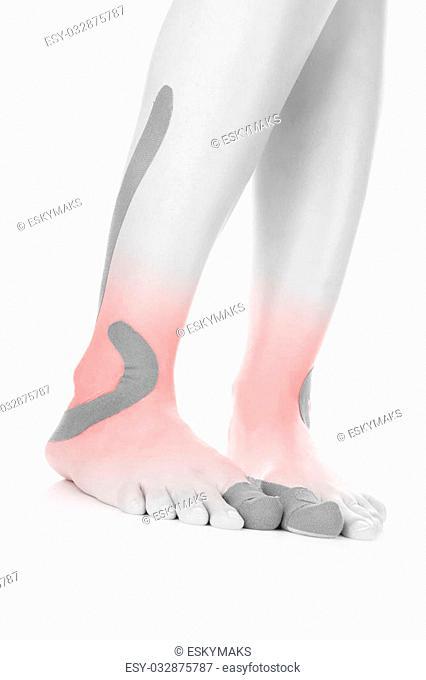 Therapeutic tape on female leg isolated on white background. Chronic pain, alternative medicine. Rehabilitation and physiotherapy