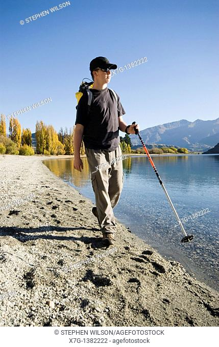 Young hiker walking at Glendhu Bay on the shores of Lake Wanaka, South Island of New Zealand