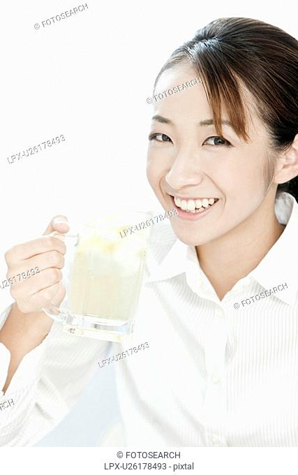 Businesswoman holding a glass of highball, Tokyo Prefecture, Japan
