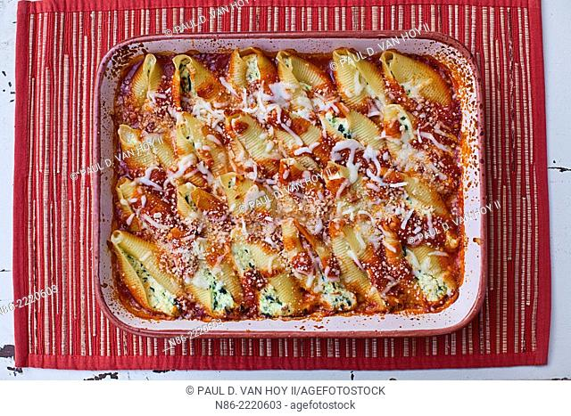 stuffed pasta shells with parmesan in a baking dish