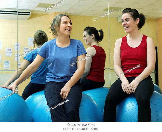 women relaxing at gym