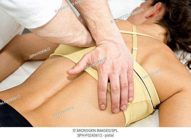 Chiropractor treating patient