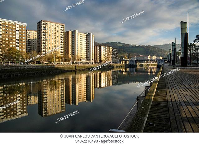 Reflection of buildings on the river Nervion. Bilbao. Vizcaya. Basque Country. Spain. Europe