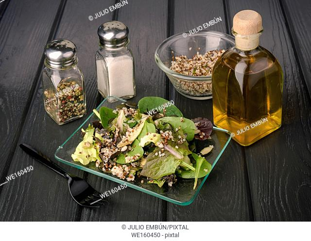 Quinoa seed salad in glass bowl on black board