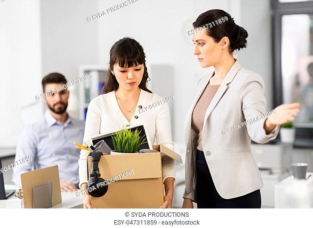fired sad female office worker leaving