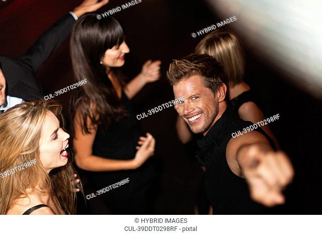 Man pointing and dancing in club