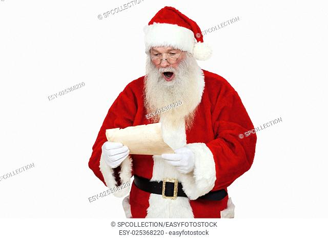 Santa Claus looking amazed on his wish list (isolated)