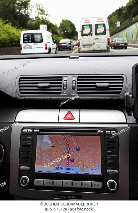 Drive on the motorway A40, so-called Ruhrschnellweg, in heavy traffic, navigation device indicating a traffic jam, Essen, Ruhrgebiet region