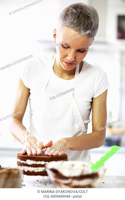 Woman pressing cake
