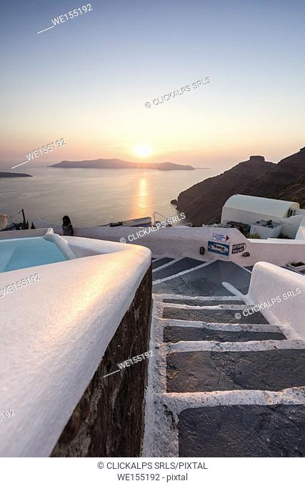 Sunset over the Aegean Sea seen from an alley of stairs of the old village of Firostefani Santorini Cyclades Greece Europe