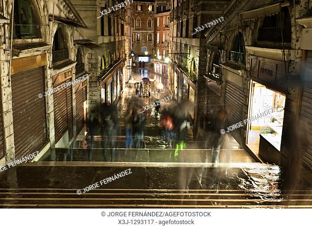Venetian street at night on a rainy day, Venice, Italy, Europe