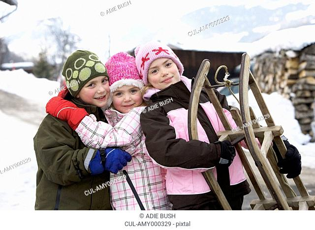 Portrait of children with sledge